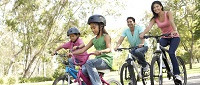 image of family biking