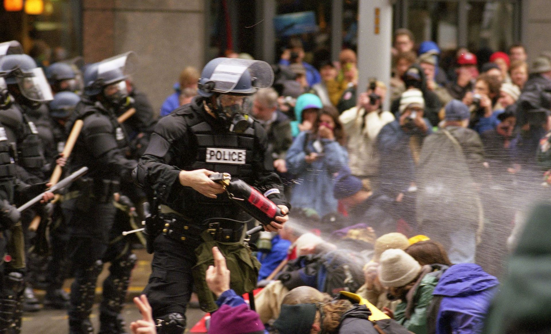 WTO protests in Seattle, November 30, 1999 Pepper spray is applied to the crowd.