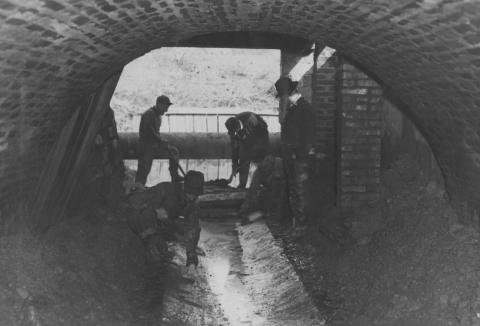 WPA relief workers laying a concrete floor in the Boneyard branch outlet.
