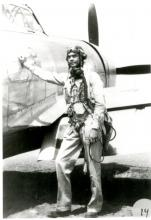 George Roberts posing by plane