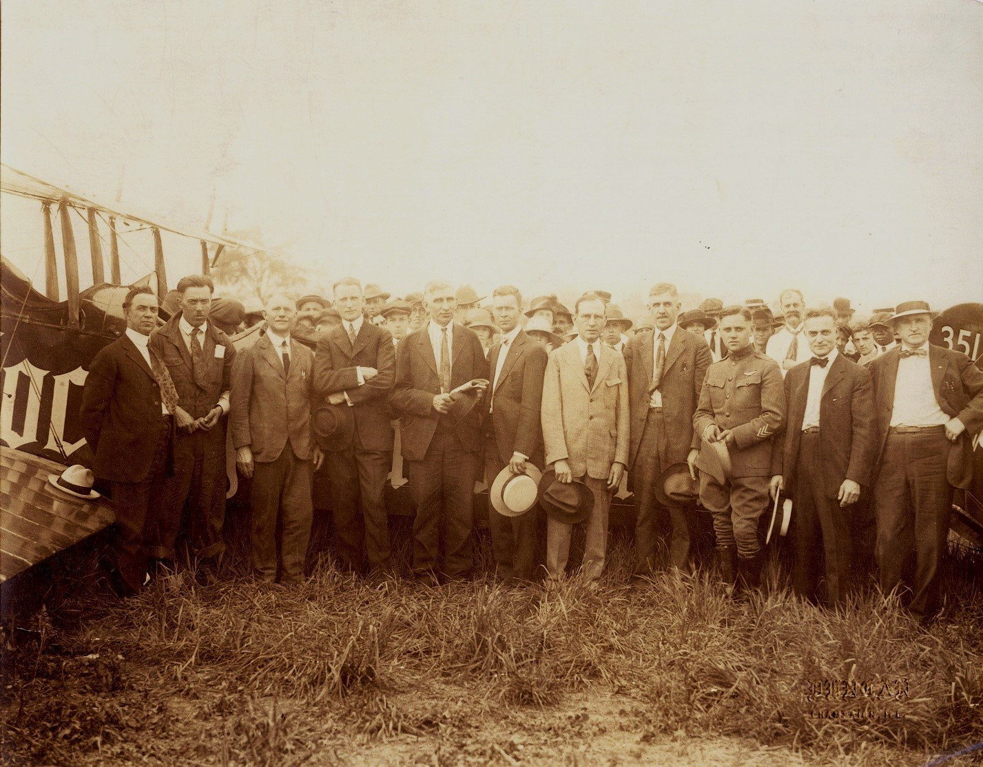 People assembled after the plane landed, Isaac Kuhn is fifth from the right, 1919.