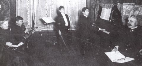 """A musical evening at the Cohen's house at the turn of the century. From left: Addie Cohen, Sydney, Sol, Julius, and Nat H. Cohen."" Image from ""Amid the Alien Corn: 100 years of Sinai Temple in Champaign, IL, 1904-2004"