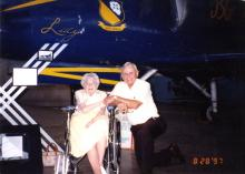 Lucy Goff and Don Weckhorst in front of plane named Lucy